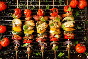 Grilling vegetable and meat skewers
